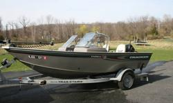 2004 Tracker Targa 16 WT (walk through) . This boat is very nice for fishing. The boat is equipped with a Mercury 60 hp engine with aluminum propeller and power Tilt & Trim. This boat is in very good condition with the exception of some minor scratches