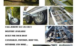 22-24' Tandem, custom sluminum boat trailer. 6,000# GVW1 set of disc brakes, front bunks, stainless steel hardware, l.e.d. lights, spare tire with mount, torsion axles, aluminum guide poles, Kodiak disc brakes, HD winch assembly with 2 speed winch with HD