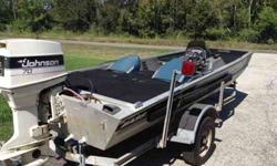 """1992 Tracker 17' with 1986 70hp Johnson. Boat has new front and rear decks. 3/4"""" treated playwood under new marine carpet.lots of storage with one locking for poles. LiveWell located between seats. Battery is one year old. Has room for 2nd battery."""