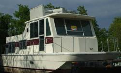 We have a 1976 Houseboat for sale. It has a bedroom, complete bath and kitchen. There are 3 decks. The people we bought if from was in the process of remodeling it. Unfortunately we haven't had time to finish it. They took the motor to someone to have it