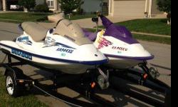 2001 Seadoo and 1999 Seadoo on a 2005 Bear double trailer. Both Seadoos are in great running condition. Just had them both checked and maintenance at Renos in KC MO. Paid $700.00 in repairs for the 1999 to have a new drive shaft, Wear Ring, Battery, Spark