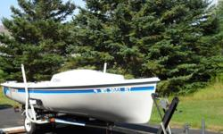 """Excellent condition, like new, with trailer and 4 hp Suzuki outboard motor, with """"custom made canvas"""" to cover the boat. $3,500.00 ***The picture of the boat in the water with the sails are not my boat.*** I just want you to see a picture of the sails and"""