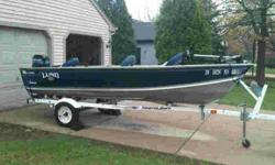 nice boat and trailer. clean title receipt for motor tuneup from 2011. 847-224-9103 leave vmail or email if interested. put lund in the subject line. both motor, boat, and trailer are 1998 alumacraft lowe star craft starcraft tracker aluminum deep vee