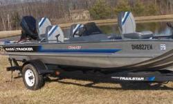 UP FOR SALE IS VERY NICE GARAGE KEPT PRO 17 BASS TRACKER POWERED BY A 40 HP JOHNSON MOTOR. HAS A NEW LOWRANCE DEPTH FINDER. BOAT HAS ORGINAL TRACKER SEATS STILL IN GREAT SHAPE, ALONG WITH CARPET. HAS MOTOR GUIDE TROLLING MOTOR AND A NICE SIZE LIVEWELL. AS