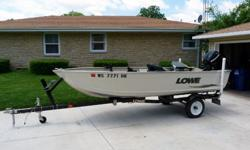 """For sale is a nice lightly used 14' 2008 Lowe Sea Nymph 1467T. Boat has a 2009 Mercury 15hp long shaft 4 stroke motor that has less than 25 hours on it. The trailer is a 2007 Karavan with new tires, sure lube hubs, and takes a 2"""" ball. The boat has a nice"""