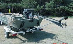 This is a 1448 SeaArk Duck Boat, bought at Cabela's with a 16' Shorelander Trailer. I have also installed a roller set and guide ons which makes it easier to load and unload. There is a remote Radio Ray search light mounted on the front. An Avery Quickset