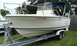 150hp Evinrude Ocean Pro with aluminum trailer. Engine is in great shape. Boat needs cosmetics.