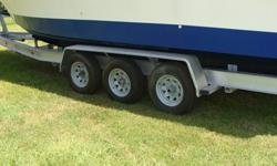 Drive on, torsion axle disc brakes-will hold up to 30' Boat. Trailer is like brand new. This trailer sells for $6200.00 new and is a 15,000 lb trailer.