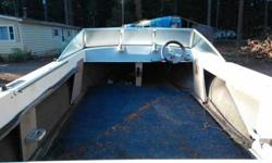 Rear rollers on trailer need fixed. Still Hook and Go!!Boat is Solid - Good Steering, Solid Floor, Good Walk through Windshield, Nav. Lamps...Basically all this boat needs is an Outboard and Seats, I have a couple if you Like.Boat is Rated 200hp Max.