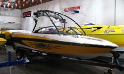 PRICE REDUCED! Save Many Thousands Over New! Loaded! 340 HP Monsoon V-Drive, Wakeboard Tower w/ Racks & Speakers, Bimini Top, Large Swim Platform, Perfect Pass, 4 Ballast System, Malibu Launch System, iPod & Satellite Ready AM FM CD MP3 Stereo System w/
