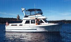 This classic Ocean Alexander 40 Double Cabin offers two staterooms and two heads and has the desirable galley up configuration. It is powered with the twin Volvo 6 cyl diesels with only 2600 hours. This boat has it all! Great accommodations, beautiful