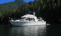 Boathouse kept 42' Canoe Cove Aft Cabin, this Alaskan Veteran is ready to go again, with cockpit, pilothouse and fully enclosed flybridge helm stations.Twin stateroom motor yacht, aft cabin master with full walk-a-round Queen bed,head with private