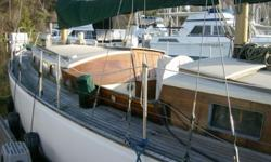 Classic Wood-boat ambience -- looks and feels like a classic '50's or '60's sweet-sheerline, long-overhang cruiser, yet she has the low-maintenance of an all-fiberglass hull! Just-completed: complete re-manufacture of the spruce main and mizzen masts, to