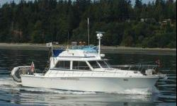 """1981 Uniflite Sedan 42,This 42' Uniflite with a 14' 9"""" beam and a 35,000 lb. displacement is the ultimate sedan convertible when it comes to stability. This boat has the most complete electronics suite I have seen. This Alaska veteran is waiting for her"""