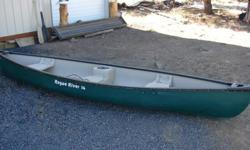 I'm selling my 14ft Rogue River canoe. Wider design than most other canoes which improves overall stability. Made from rugged polymer materials. Three molded-in seats with a drink cooler in the middle seat. Two molded handles at the front and back make