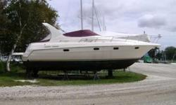 Just Reduced! 1998 Cruisers Yacht 3375 Esprit with new bimini sunbrella top and zip out windows, mooring cover, new twin 454 7.4L Mercruiser engines, vberth sleeps 2, contemporary galley dinette with leather seating and cherry wood table top that converts