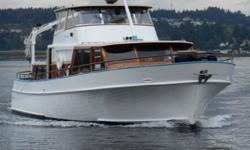 """Heavily built wood motoryacht designed by Grenfell and built by Osborne Shipyard in Vancouver BC. Always kept undercover. Single 325 HP Deutz diesel with bowthruster. Seller is a meticulous boat owner. """"Just One"""" is a head turner wherever she travels."""