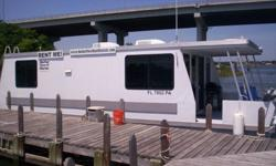 Vagabond 40ft House Boat. It just keeps getting bigger and better! All the comforts of home on the water! Bring a good book, relax the bedroom, take a hot shower or jump into the water with a splash! Its all good! This catamaran boat is powered by a 115hp