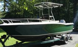 DESCRIPTION1988 Larson Center Console Deep V1999 Outboard Motor - 115 HP Johnson 2 Stroke W/ Hydraulic Steering.....Less than 300 hours....T-Top and Leaning PostVHF Radio, Garmin Fish Finder, Radio w-c/d player, All gauges and panel like new condition.All