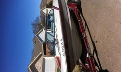 """Like new condition! 17'3"""", 175 HP, waterskis and tube included!"""