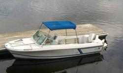 Wellcraft V-20 step lift. 1988. Enclosed cuddy, approx. 20 gal. live well, Bimini top and full snap enclosure, 175 HP Evinrude outboard motor. Boat is in excellent condition.