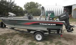 97 Tracker 17' Pro V single console. This is a perfect straight up fishing machine. Has a Merc 70HP 2 stroke with hydraulic tilt and trim, runs at 33 MPH with 2 but will slow down to 1.5 - 2 for trolling. Handles rough water very well, 17' pro V platforms