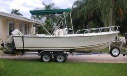 Center Console boat very good shape/condition for age, original haul, no bottom paint, no soft spots on deck. New seat cushions for cooler & front console, new windshield, large Bimini top, depth finder, 50 gallon gas tank and anchor with 100ft of rope.