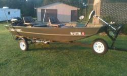 2006 1442 Alumacraft Boat,Dixiecraft Trailer,and 15HP 4stroke Mercury motor,with 30 lb thrust trolling engine.boat has been in the water maybe 15 times and always kept inside,asking $4,500 neg. please call Lee at 601-416-1713 .See item listed at http