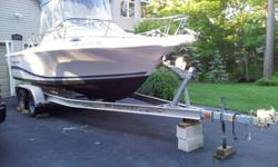 2004 Pro-Line 20' Walk-Around w. Cuddy Cabin, 2004 EZ-Loader Tandem Trailer, 2004 Mercury 150 HP Saltwater Series motor. Great, dependable, well-maintained! Boats NASA Guide boat value alone is over $19,000. Boat has new Wise Company Cushioned Cooler