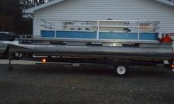 Playbuoy Pontoon in excellent shape. 35 horse Johnson motor, carpeted, with a optional roof minus the canvas, 6 seater, compartment seats, captains chair, and on a Hoosier trailer that tows like its not even there. Just in time for the fun and sun!