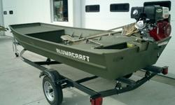 NEW 1442 HUNTING BOAT AND A 13 HP BEAVERTAIL LONGSHAFT MOTOR, AND A TRAILER READY TO GO.