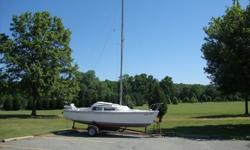 The boat has been outside for its whole life (since the mid 70's) but I have sails and cushions that have been stored inside. The mast, boom, rudder, tiller, etc, are all up for offer, as is the trailer.The sails seem to be in good shape, though there is