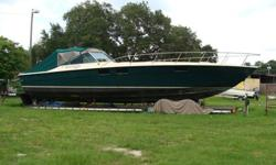 Twin 692 TIs 450hp each. One engine runs good. One out of the boat-needs overhaul. Custom teak cockpit flooring with aluminum hydraulic hatches. Full canvas enclosure. Full galley with Corian counters throughout. New headliner, 2 new hatches on