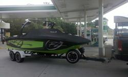 Lime & Black RZ2 W only 285 hrs kept inside when not in use. 2250lbs of ballast. 4 wet sound speakers on tower. Perfect pass. Easy fill ballast. TAPS. Insulated ice chest. Extra stereo control added to front seats. Want more or better pics call or text me