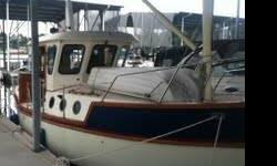 WHAT IS THIS? A Mini-Nordhavn?? Well, not exactly, but the spirit and design-philosophy are very similar ? indeed, she?s a similarly-endowed long-long-distance proper (and SAFE) motor yacht? . Shes a 1992 Legacy 32' Trawler very unique. Yanmar IB Diesel