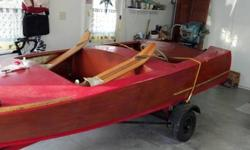 Hand made 14' wooden boat. Very good condition. Includes 15hp Evinrude and trailer. $5k or Best Offer