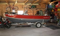 1983 Lund American Tyee fishing boat. Has 115 Evinrude motor and 9.8 Mercury kicker. Hummingbird fish finder with GPS and auto pilot trolling motor. Live well, onboard triple battery charger and full canvas boat cover. Selling as we don't get a chance to