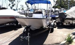 """VERY CLEAN, 1963 17' BOSTON WHALER MONTAUK (originally known as the """"nauset"""") AND TRAILER. JOHNSON 85HP MOTOR, ANCHOR, BAIT TANK, MAGMA FISH CLEANING STATION (REMOVABLE), NEW BIMINI TOP, NEW BOAT COVER, NEW CABLE WENCH, ROD HOLDERS (FIXED AND REMOVABLE),"""