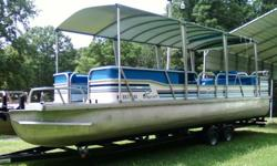 28' Playcraft full cover hardtop pontoon boat with trailer in good condition. It has a 80hp Mercury outboard motor, runs good. Great party boat or for family.