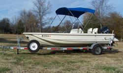 1994 Scout 162 Sportfish Center Console, 70 HP Evinrude PT/T, Galvanized Trailer, Boat Cover & Bimini Top/boot cover, 2 bait wells- one aerated, 2 lockable rod storage compartments, lockable front storage compartment, anchor well with anchor, 48 QT
