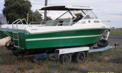 For Sale! 1974 21ft Winner cuddy cabin. Mechanic special as it does not run, but I have the replacement motor that comes with it. It is on an EZ-Loader trailer and I just want it gone because I bought a new boat. I am asking $600 but I am open to all