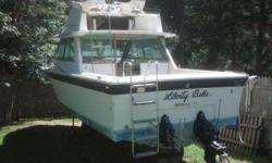 this boat is very solid all lights fridge water and bath work this boat has no engines and one out drive very solid hull email (click to respond) or 700.00 or best offer must sell before winter dont have the money to fix getting divoredListing originally