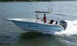 Evinrude 200HP J/E 2-stroke, jump seats, freshwater wash, shrink wrap w/ zipper, limited edition package, engine installation, bahama blue color band, blue console cover, t/top drop curtain, t-top blue electronics Stock ID