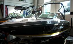 340hp upgrade, water strainer, docking lights, under water transom lighting, logo storage cover, transom audio remote, progressive tower, heater, tandem trailer with spare tire, runway lighting. We?ve redesigned the helm station with a lower dash and a