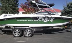 This Super Air Nautique 230 Team Green machine is loaded to the hilt. It has every option that was available in 2008. 2 set's of tower speakers, Z5 bimini, swivel racks, table, heater, bow and walk-thru filler cushion, reversible/removable center seat,