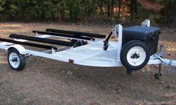 1994 Yacht Club Double Jet Ski Trailer with spare and rolling tongue jack. Has new axle springs, treated bunk boards and turf. Storage box included, or can deduct $ 45.00 from price if you don't need the storage box?