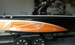 2013 Tige Z3 Only 80 Hours! Year End Blow Out Pricing Only $69,995 Trades Welcome! Financing Available O.A.C.!* PCM 5.7L 343 Excalibur* Black / Tangerine / Stone Gelcoat* Alpha Z Tower with Black Bimini Top* Snap In Carpet* Black Rubrail* Surf Ballast