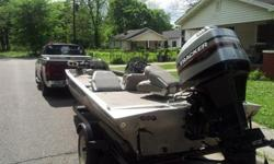 1997 17.5 ft bass tracker and trailer, 75 hp Mercury engine with new starter and cables, chrome propeller, runs very good, working trolling motor with new trolling seat, two fish and depth finders,3 new batteries, (2 for trolling, 1 for engine), 3 seat