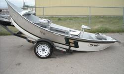 This 2003 Hyde 16.8? High Side Drift Boat is well equipped! This boat includes a G4 super shoe for strength and slickness, bow storage compartment with door, deep front storage box with 2 Tempress fishing seats, a triple lid rowers storage box with low