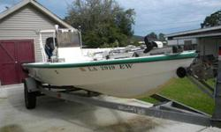 A shallow water poling skiff with a platform. 2001 OPTIMAX 150 saltwater series with four blade SS propeller. Hydraulic steering, jack plate, and trim tabs. Also installed in the middle console are AM/FM CD radio, GPS, depth finder and VHF, all in